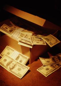 Shoebox filled with hundred dollar bills