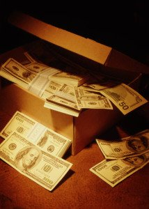 Shoebox filled with hundred dollar bills